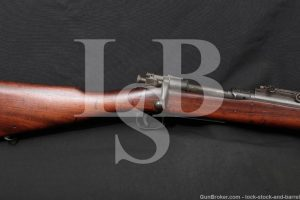 """LSB#: 201021MW25 Make: Rock Island Arsenal (RIA) Model: 1903 Serial Number: 392128 Year of Manufacture: 1919 (page 373 of Joe Poyer's book, The M1903 Springfield Rifle and its Variations, 3rd Edition) Barrel Date 7 - 43 Caliber: .30-06 Springfield Action Type: Bolt Action, Internal Magazine Markings: The top of the receiver is marked """"U.S. / ROCK ISLAND / ARSENAL / MODEL 1903. / 392128"""". The top of the Remington replacement barrel is marked """"RA / flaming bomb / 7 - 43"""". The bottom of the barrel is marked """"P"""". The front sight hood is marked """"R"""" on the right and """"flaming bomb / U.S."""" on the left. The magazine cutoff is marked """"ON OFF"""" and the safety is marked """"SAFE READY"""". The barrel band is marked """"U"""". The top of the bolt handle is marked """"N L / 3"""" and the bottom is marked """"k"""" & with a punch. The left side of the stock, above the trigger, is marked with a faded Ordnance Department """"crossed cannons"""" cartouche and """"FJA in a box"""" (inspector Frank J. Atwood, Remington Arms/Smith Corona 1942-1944, page 399 of The M1903 Springfield Rifle and its Variations, 3rd Edition). The left side of the stock, above the magazine, is marked """"C.S.A.A. in a rectangle"""" which is a post WWII Arsenal Rebuild stamp from the San Antonio Arsenal (page 390). The bottom of the grip is marked """"K"""" and with a """"circled P"""" proof. The wood ahead of the magazine is marked with 4 inspection stamps that consist of """"numbers inside of shapes"""". Barrel Length: Approximately 24 Inches Sights / Optics: The front sight is a blade set atop a barrel mounted base. It is set under a removable protective hood. The rear sight is a """"U"""" notched blade attached to a fully adjustable sight ladder marked from """"3-27"""". When flipped up separate notches and an aperture on the ladder can be used for sighting. Stock Configuration & Condition: The hardwood stock has a straight grip, metal nosecap, stacking loop, barrel band, 2 sling loops, 2 reinforcing pins, and a metal buttplate with hinged door for storage. The buttplate shows """